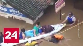 На западе Индии мощное наводнение: власти обратились за помощью в эвакуации к военным - Россия 24