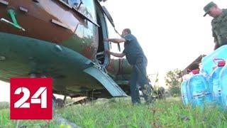 Военные доставили гумпомощь в отрезанный от мира поселок под Иркутском - Россия 24